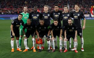 Manchester United players pose for a team group photo before the match.