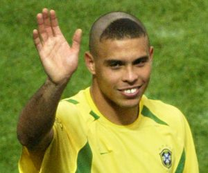 Brazil's goalscorer Ronaldo waves to the crowd.