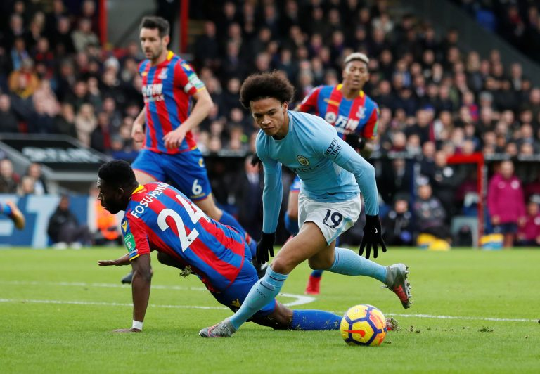 Crystal Palace's Timothy Fosu-Mensah in action with Manchester City's Leroy Sane.