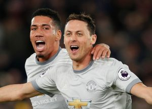 Manchester United's Nemanja Matic celebrates scoring their third goal with Chris Smalling.
