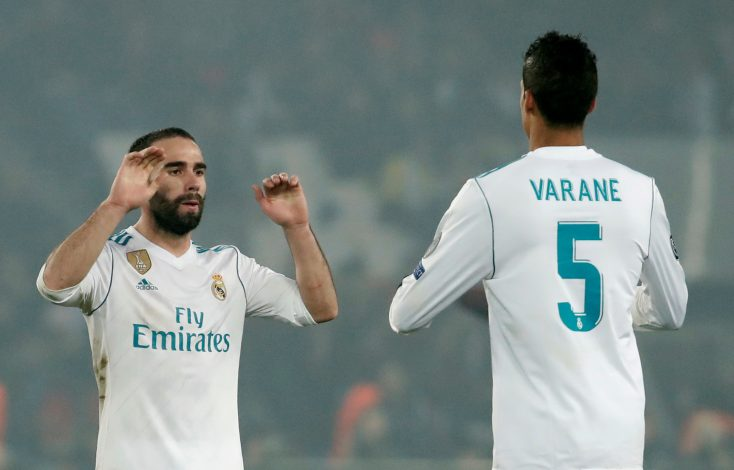 Real Madrid's Dani Carvajal and Raphael Varane celebrate after the match.
