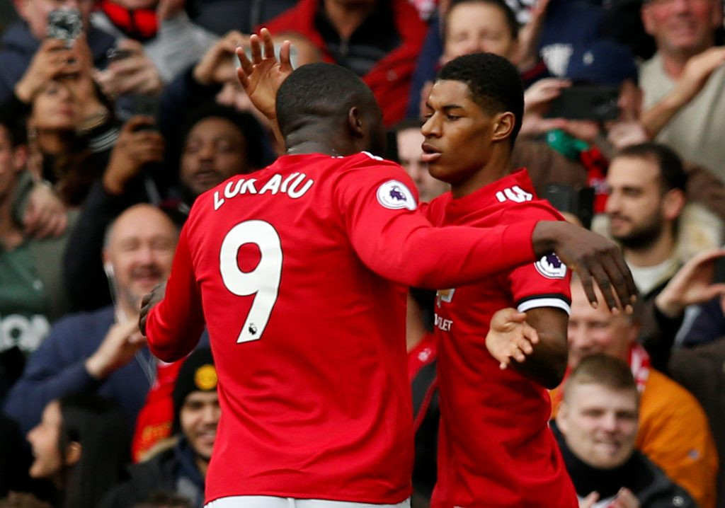 Manchester United's Marcus Rashford celebrates scoring their first goal with Romelu Lukaku.