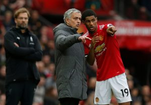Manchester United manager Jose Mourinho gives instructions to Marcus Rashford.