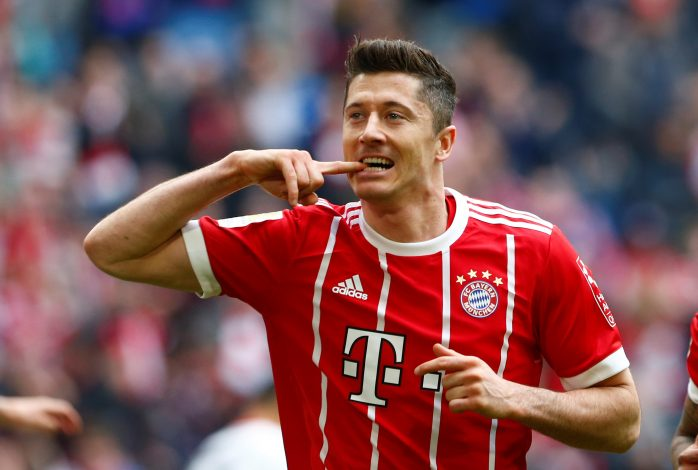 Bayern Munich's Robert Lewandowski celebrates scoring their third goal.