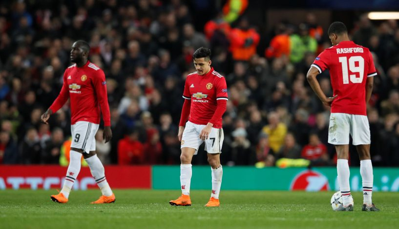 Romelu Lukaku and Alexis Sanchez look dejected.