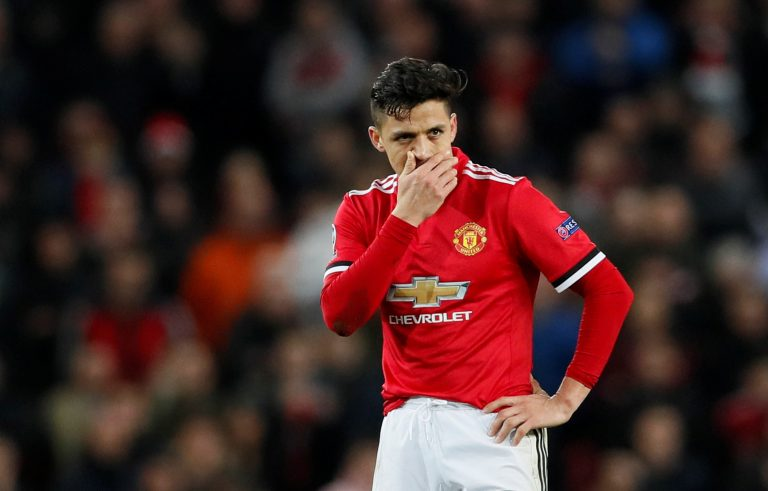 Alexis Sanchez looks dejected.
