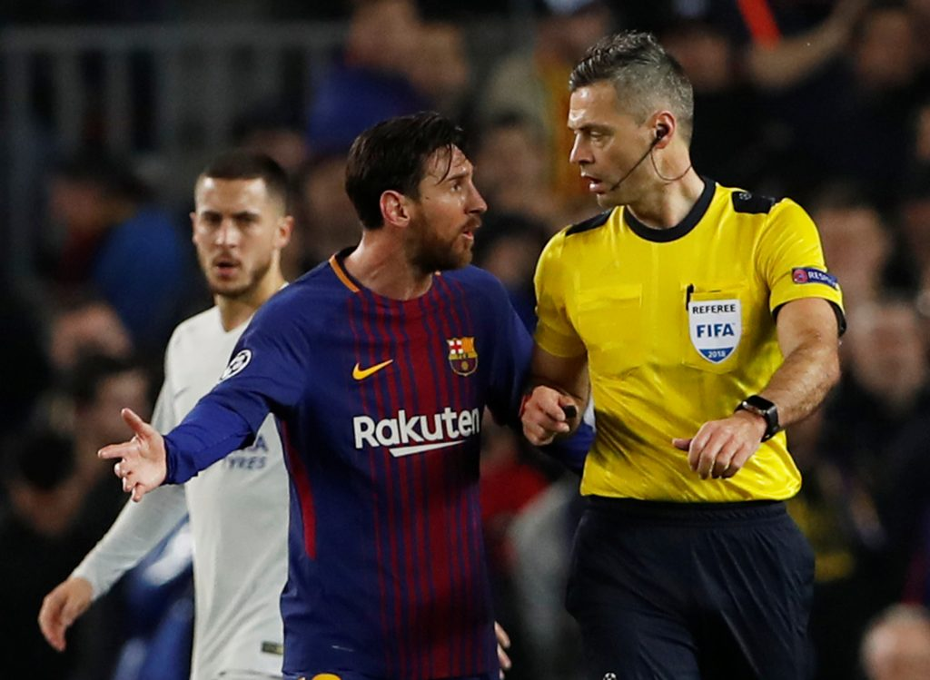 Barcelona's Lionel Messi speaks with referee Damir Skomina.