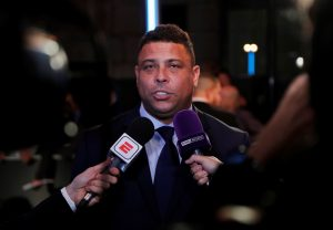 Former Brazil player Ronaldo is interviewed before the start of the awards.