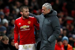 Jose Mourinho speaks with Luke Shaw as he is substituted off.