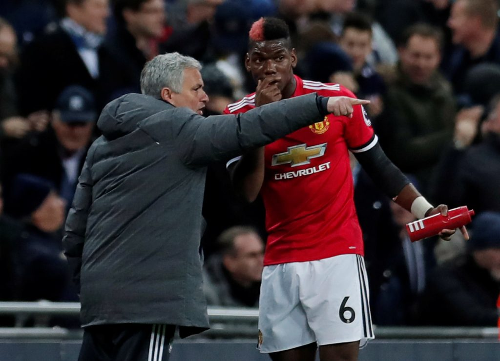 Manchester United's Paul Pogba receives instructions from manager Jose Mourinho.
