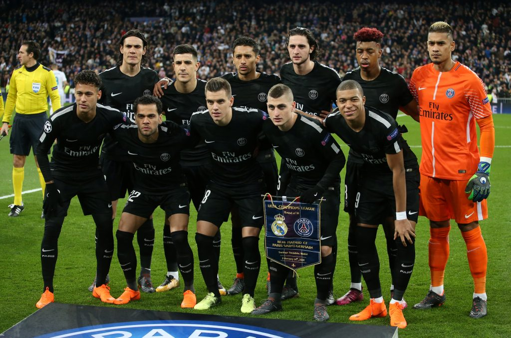 Paris Saint-Germain players pose for a team group photo before the match.