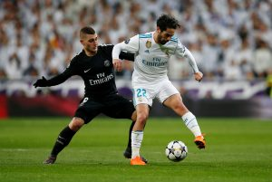 Real Madrid's Isco in action with Paris Saint-Germain's Marco Verratti.