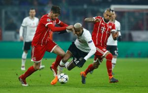 Besiktas' Anderson Talisca in action with Bayern Munich's Javi Martinez and Arturo Vidal.