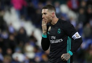 Real Madrid's Sergio Ramos celebrates scoring their third goal from the penalty spot.