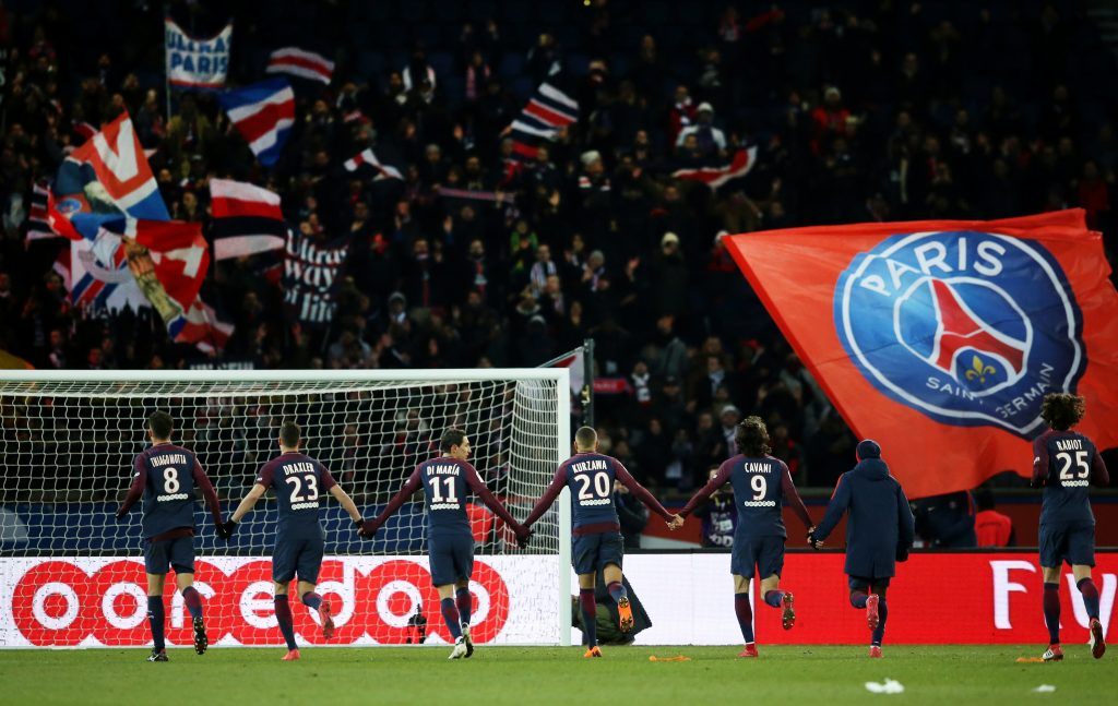 Paris Saint-Germain players celebrate in front of their fans after the match.