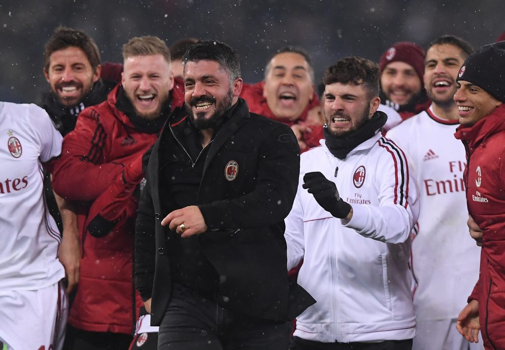 AC Milan coach Gennaro Gattuso and players celebrate after winning the penalty shootout.