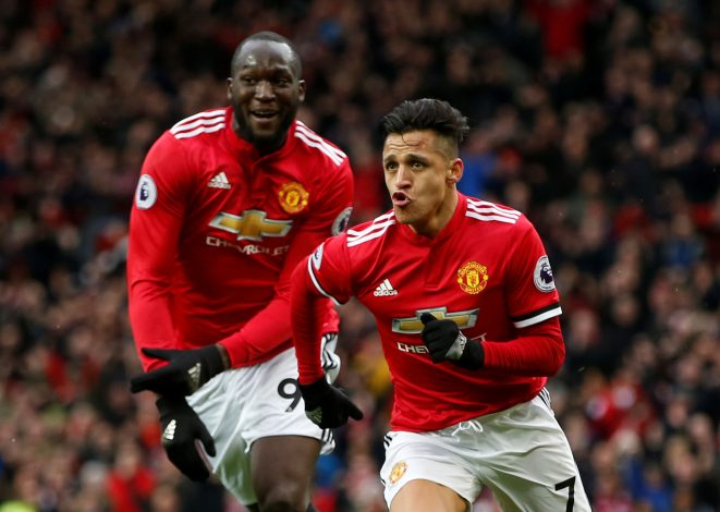 Manchester United's Alexis Sanchez celebrates scoring their second goal with Romelu Lukaku.