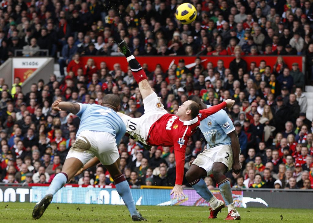 Wayne Rooney scores against Man City from an overhead kick during their Premier League soccer match.