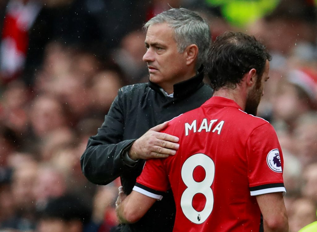 Juan Mata with Jose Mourinho after being substituted.