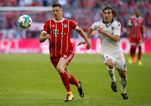 Bayern Munich's Robert Lewandowski in action with SC Freiburg's Caglar Soyuncu.