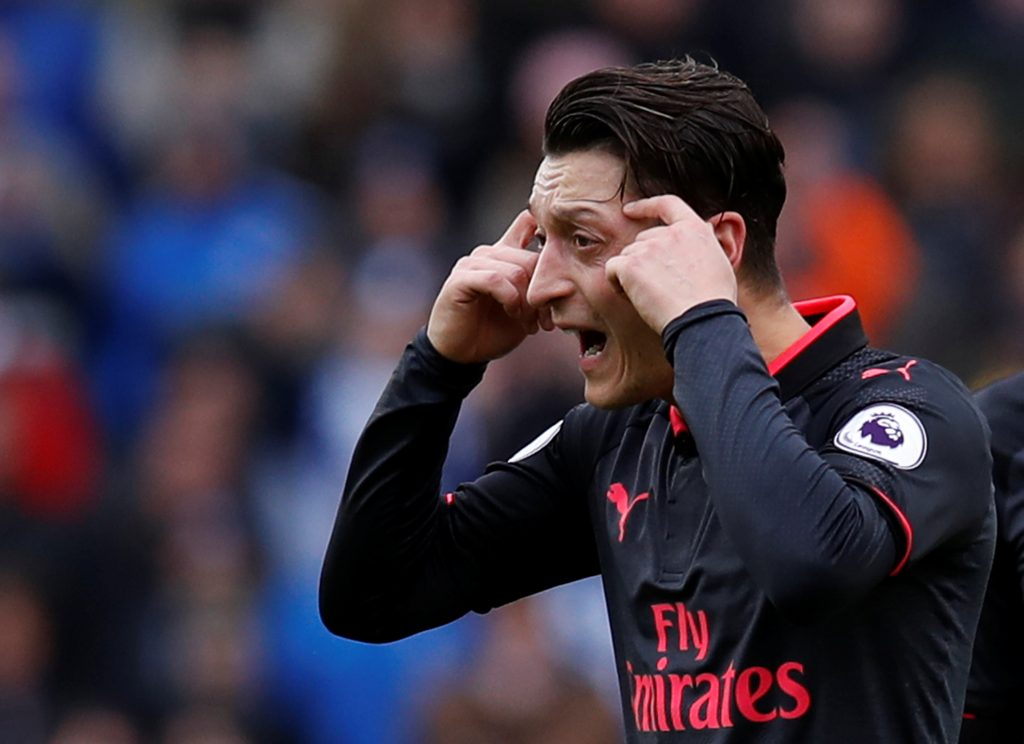 Arsenal's Mesut Ozil looks dejected after Brighton's second goal scored by Glenn Murray.