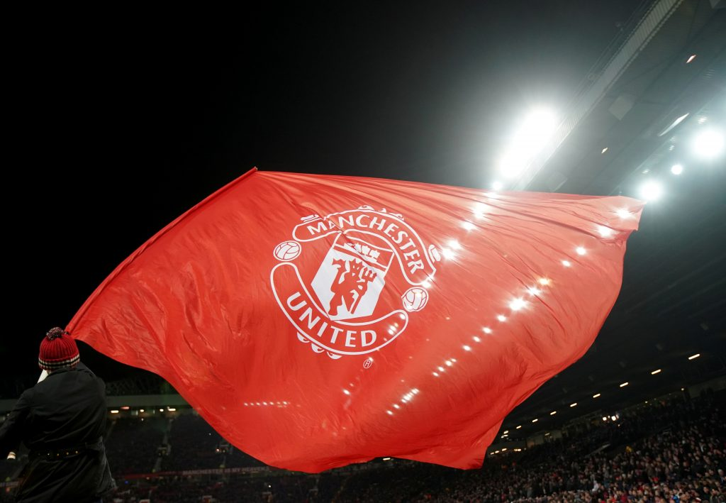 A Manchester United flag is waved before the match.