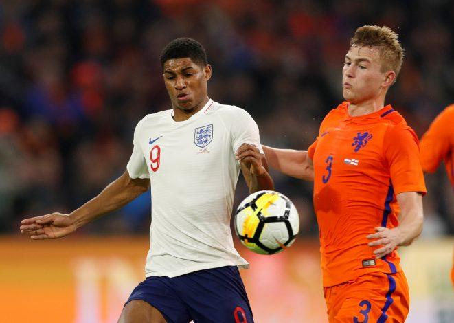 England's Marcus Rashford in action with Netherlands' Matthijs de Ligt.