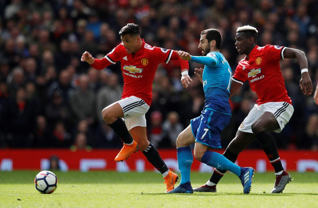 Manchester United's Alexis Sanchez in action with Paul Pogba and Arsenal's Henrikh Mkhitaryan.