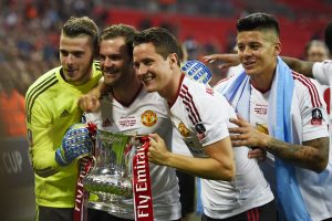 David De Gea, Juan Mata, Ander Herrera and Marcos Rojo celebrate with the trophy after winning the FA Cup.