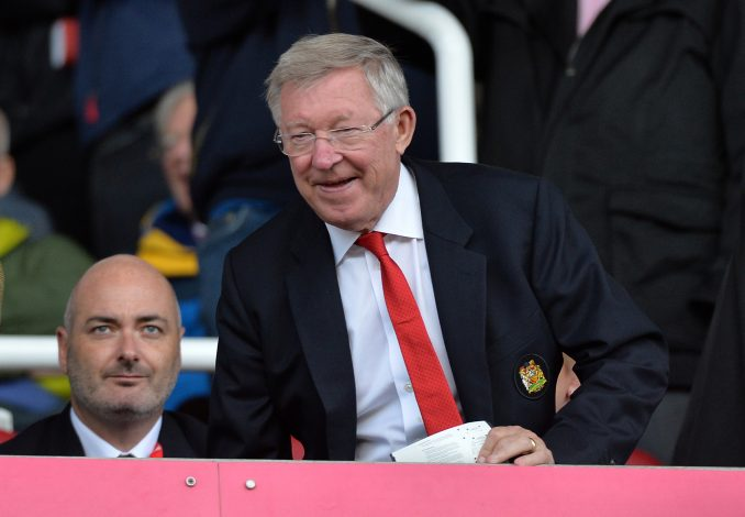 Sir Alex Ferguson watches the match from the stands.