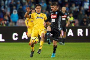 Juventus' Paulo Dybala in action with Napoli's Jorginho.