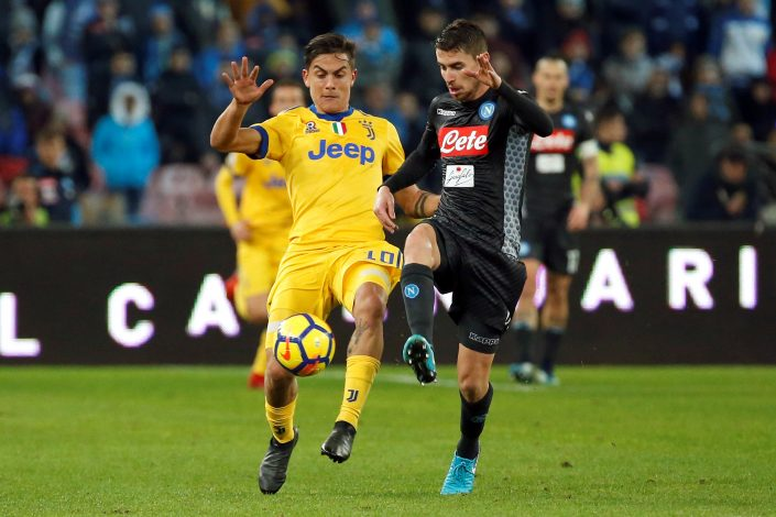 Juventus' Paulo Dybala in action with Napoli's Jorginho.