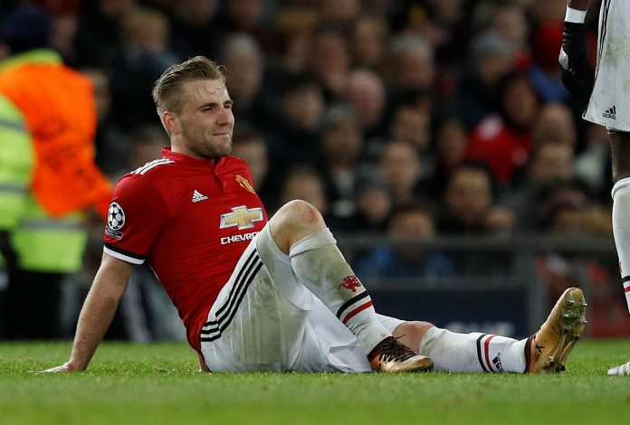 Manchester United's Luke Shaw lies injured.