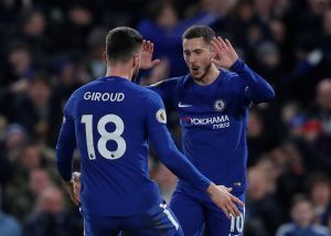 Chelsea's Eden Hazard celebrates scoring their first goal with Olivier Giroud.