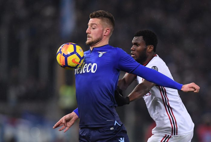 Lazio's Sergej Milinkovic-Savic in action with AC Milan's Franck Kessie.