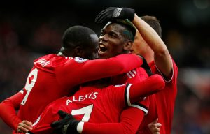 Manchester United's Alexis Sanchez celebrates scoring their second goal with Romelu Lukaku, Paul Pogba and teammates.