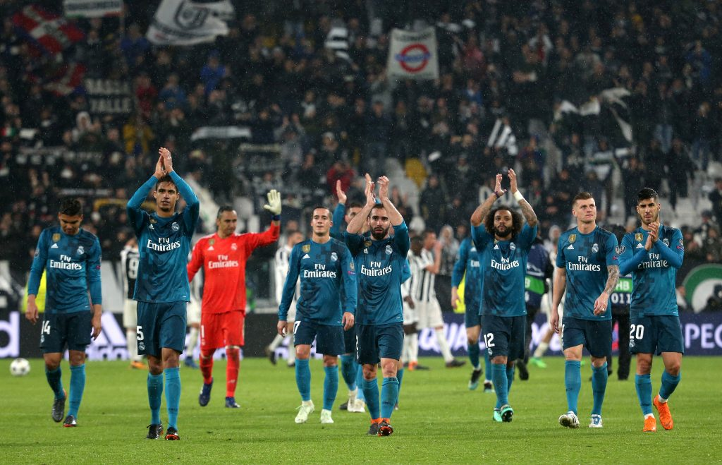 Real Madrid players applaud fans as they celebrate after the match.