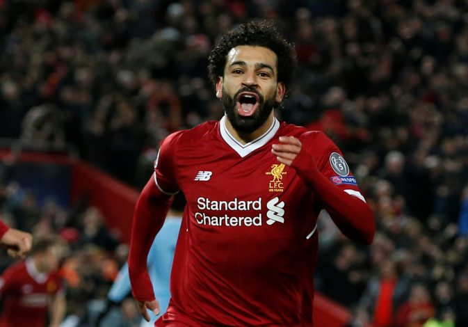 Liverpool's Mohamed Salah celebrates scoring their first goal.