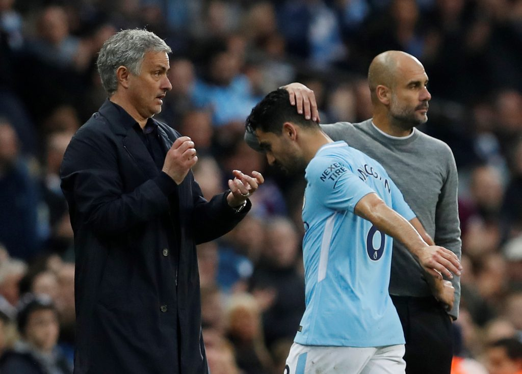 Ilkay Gundogan is substituted off as managers Pep Guardiola and Jose Mourinho look on.