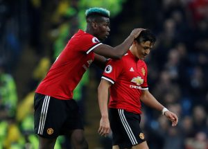 Alexis Sanchez is substituted off as Paul Pogba looks on.
