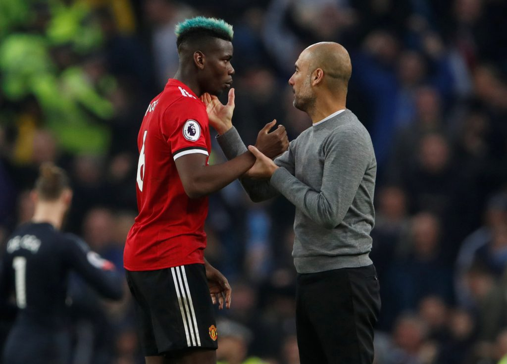City manager Pep Guardiola and United's Paul Pogba after the match.