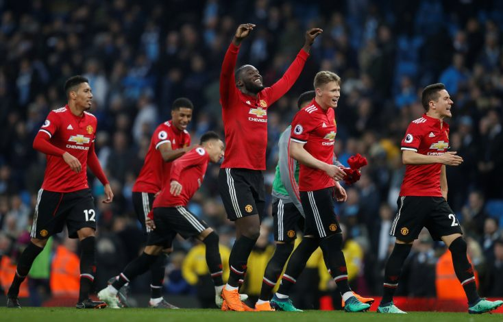 Manchester United's Romelu Lukaku and team mates celebrate after the match.