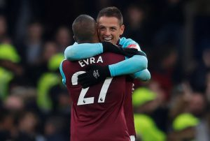 West Ham United's Javier Hernandez and Patrice Evra celebrate after the match.