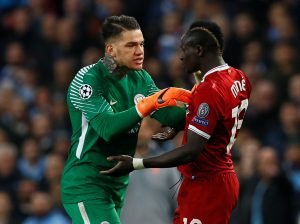 Man City's Ederson clashes with Liverpool's Sadio Mane.