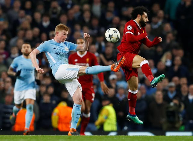 Man City's Kevin De Bruyne in action with Liverpool's Mohamed Salah.