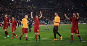 Roma's Alessandro Florenzi, Daniele De Rossi and team mates celebrate after the match.
