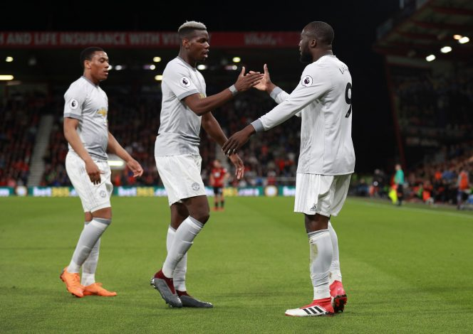 Manchester United's Romelu Lukaku celebrates scoring their second goal with Paul Pogba and Anthony Martial.