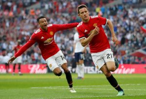 Manchester United's Ander Herrera celebrates scoring their second goal with Jesse Lingard.