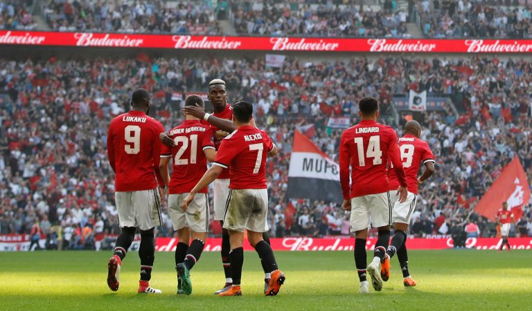 Manchester United's Ander Herrera celebrates scoring their second goal with teammates.