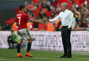 Alexis Sanchez shakes hands with manager Jose Mourinho after being substituted off.